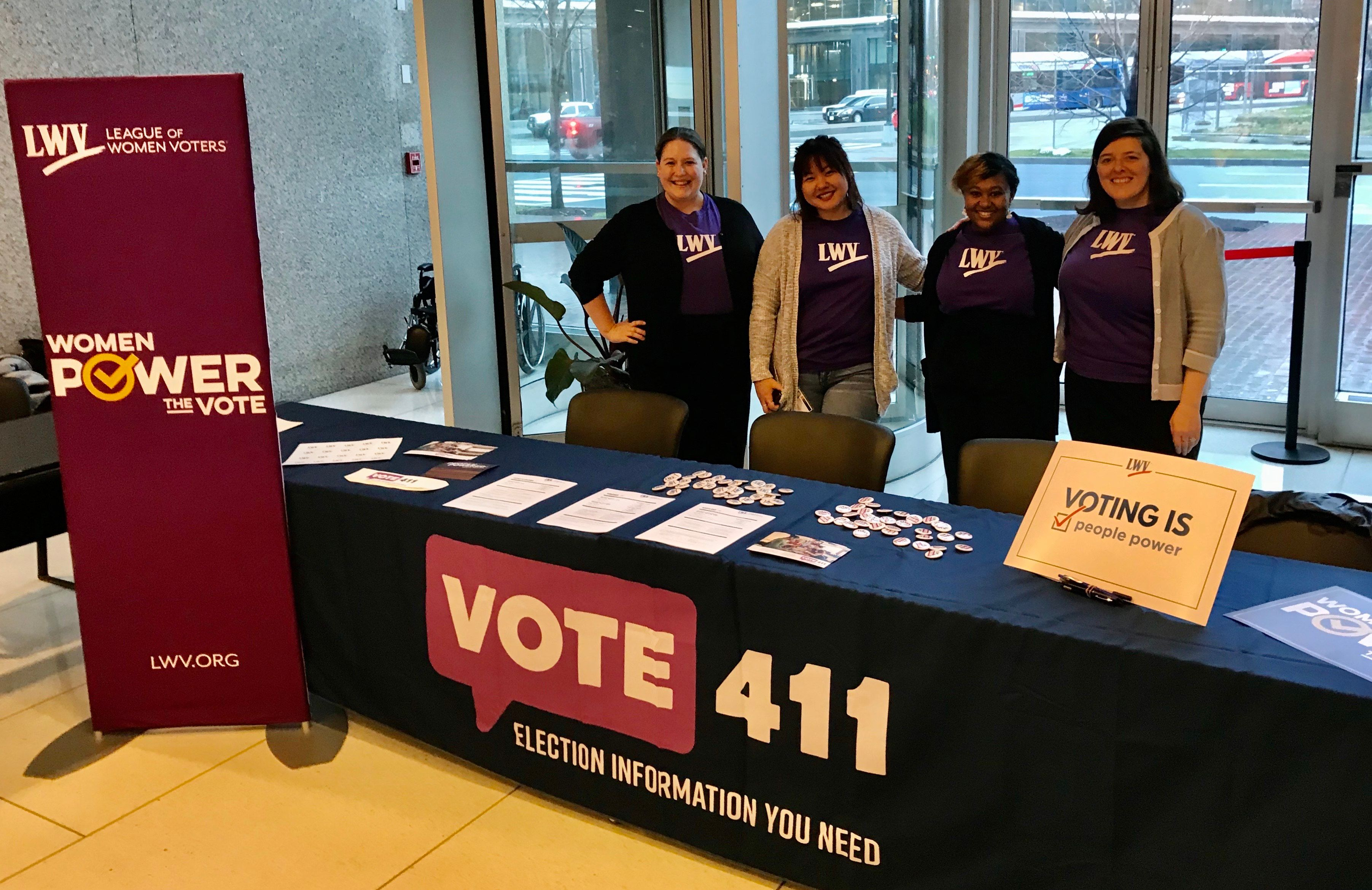 League staff at United State Citizen and Immigration Services giving voter information.